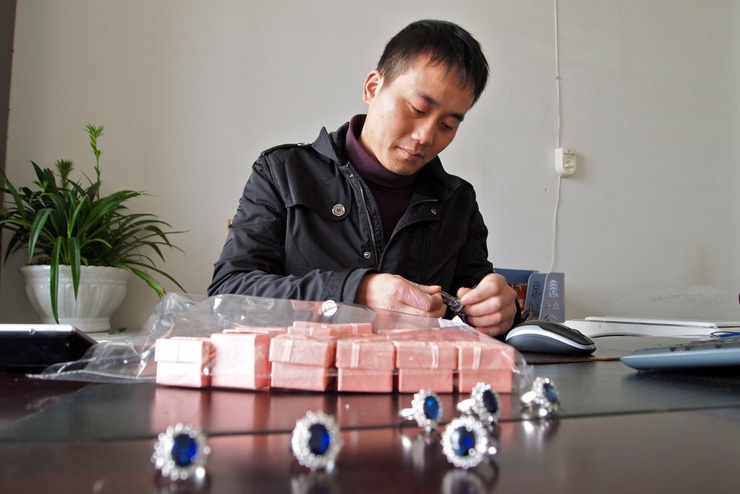 Pictured, 'Zhou Minwang who came up with the idea for the Princess Diana Engagement Ring, a replica produced by his MingWang Jewelry Factory in Yiwu, Zhejiang, China'