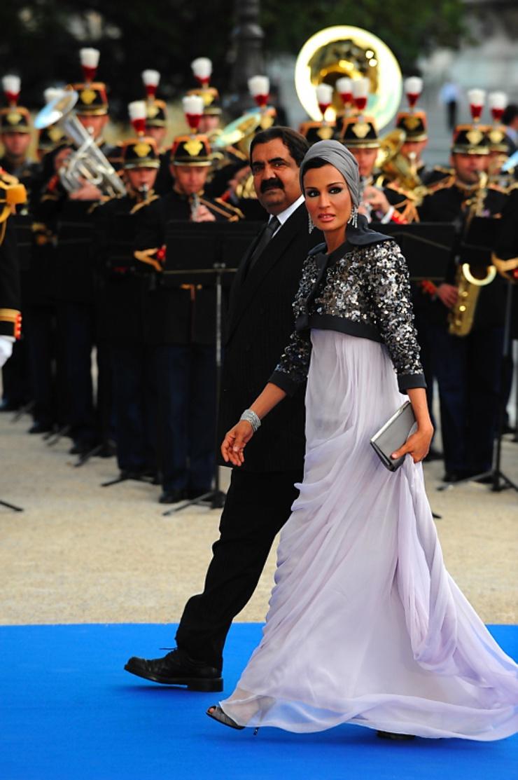and his wife Sheikha Mozah Bint Nasser Al Misned