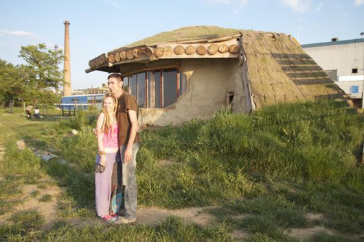 Tatjana and Dragan by their 'hobbit' house.