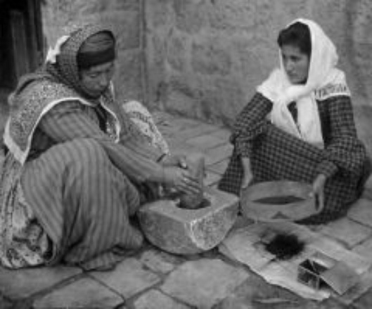 Palestinian women grinding coffee the old fashioned way, 1905