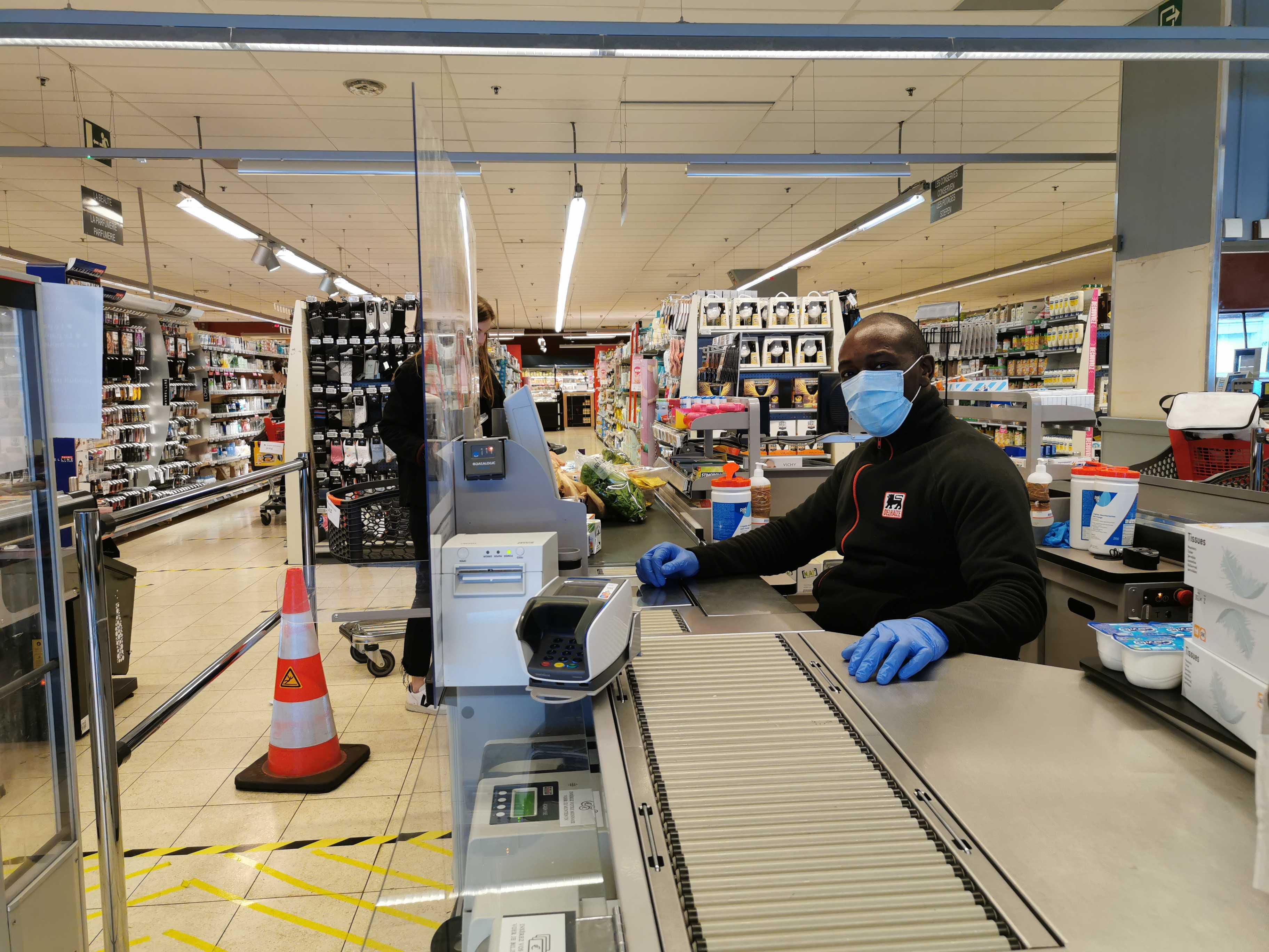 Cajero de un supermercado en Bélgica