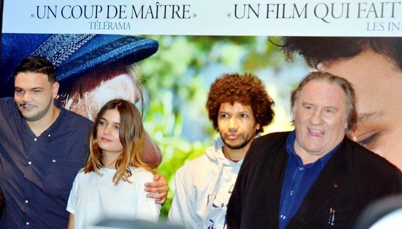 Image for Depardieu in giro per la Francia tra rap e pittura