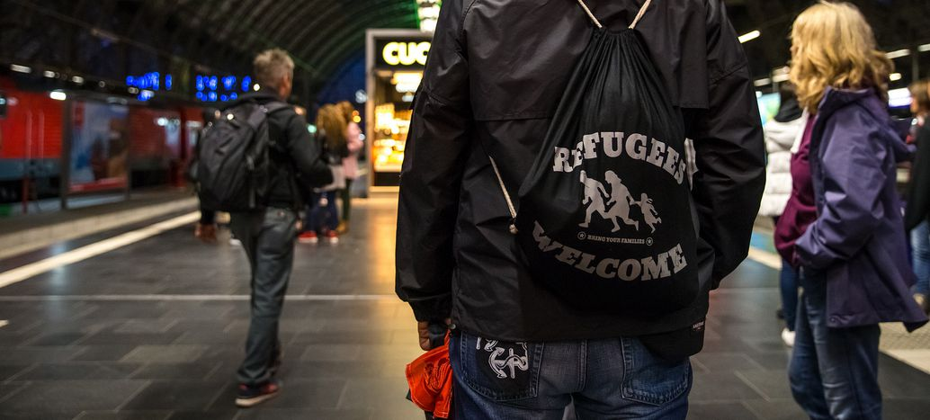 Image for The refugees turned volunteers at Amsterdam Centraal